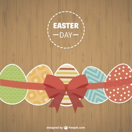 Easter Eggs on Wood Background Free Vector