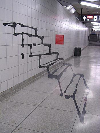 Graffiti in a subway with the illusion of 3 dimensional stairs leading through a wall