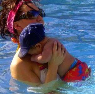Mommy teaching swimming lessons
