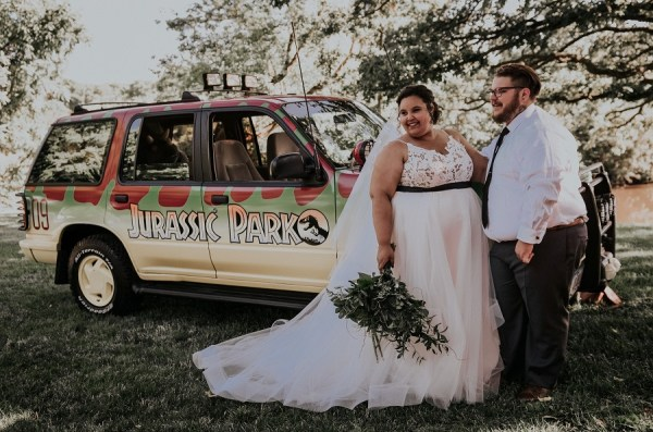 Courtney McMillion and Billy McMillion wedding ceremony photo near themed decorated Jeep