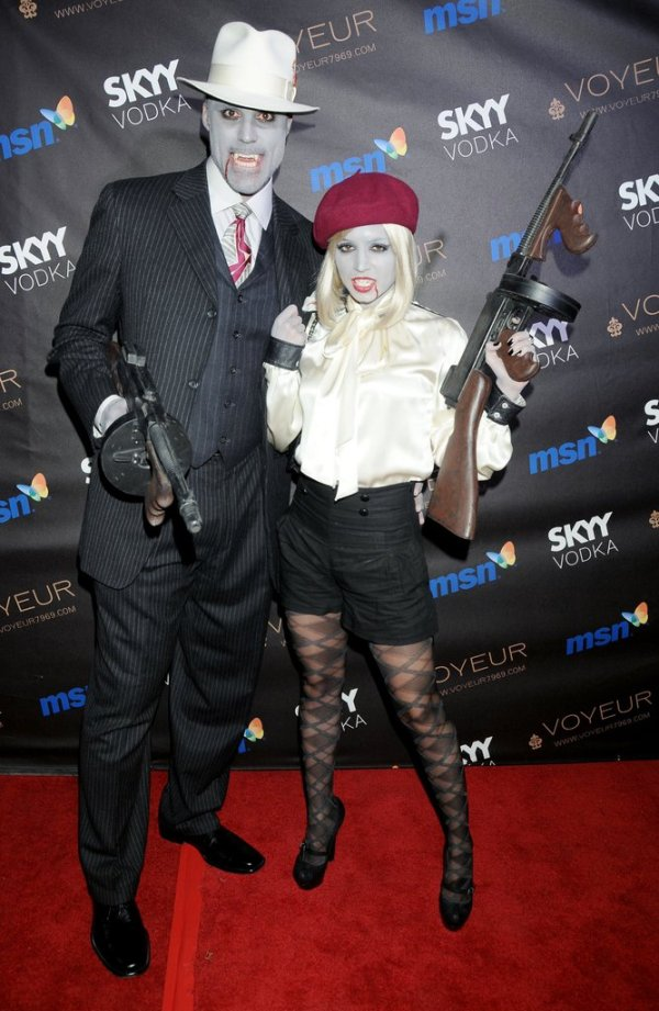 Halloween dress of Rick Fox and Eliza Dushku in 2009