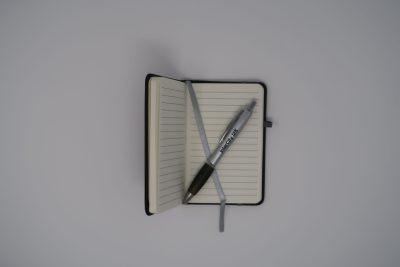 IC125 Notebook and pen open