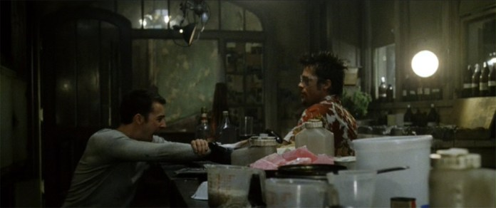 """Fig. 4: Et andet eksempel fra Fight Club er dialogen fra den scene, hvor Tyler Durden ætser fortællerens hånd med lud: """"Tyler: This is your pain. This is your burning hand. It's right here. Look at it. /Fortælleren: I'm going to my cave. I'm going to my cave and I'm going to find my power animal./ Tyler: No! Don't deal with this the way those dead people do. Deal with it the way a living person does."""" (mine understregninger)"""