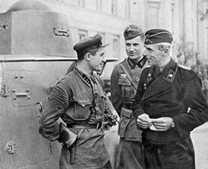 Soviet and Nazi officers standing next to the Soviet tank in Poland. September, 1939.