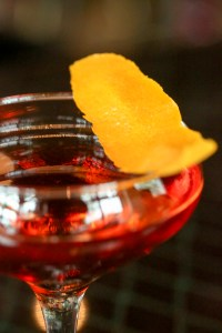 Order up an Azzurri cocktail, a vibrant blend of bourbon, sweet vermouth, Curaçao, Campari and black walnut.