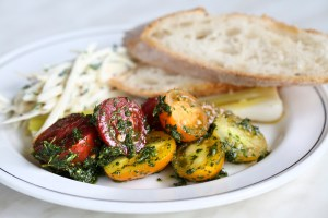 Red and yellow herb-marinated tomatoes pair perfectly with fresh crusty bread.