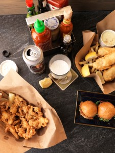 Fried clams, fish and chips and crispy oyster sliders are among Island's Creek Oyster Bar's fresh-from-the-sea treats.