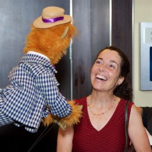 A String Fling attendee makes a new puppet friend.