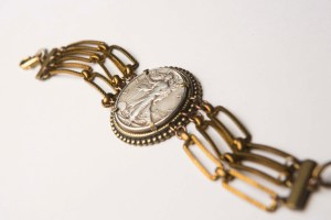 A bracelet featuring a Walking Liberty half dollar coin retails for $218.