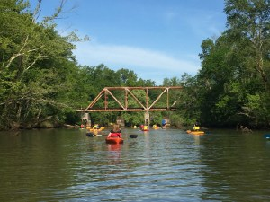 Kayaking near a railroad trestle on Betty's Branch.