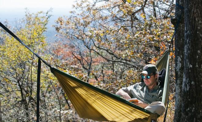 The author takes a book break along the Benton MacKaye Trail.