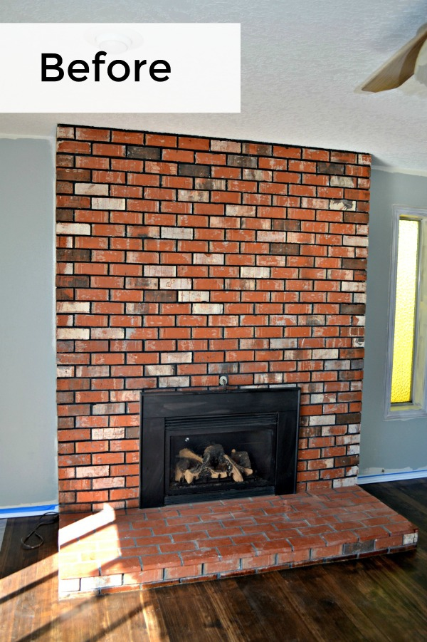 Outdated living room fireplace with red, multi-colored brick is transformed with whitewash