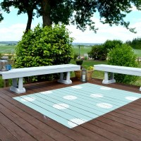DIY: Paint a rug on a deck and add a pretty design element with a flower stencil