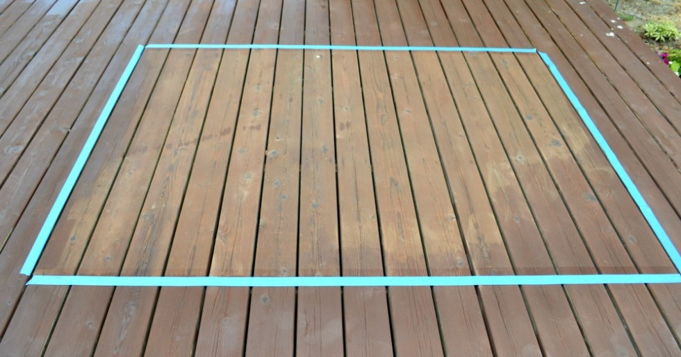 Taped off section of deck for painted faux rug