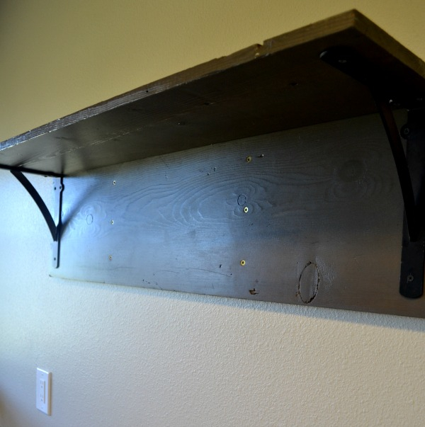 Installed shelf in laundry room ready for faucet hooks