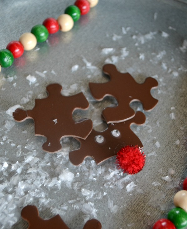 Puzzle piece reindeer can be made into ornaments or magents