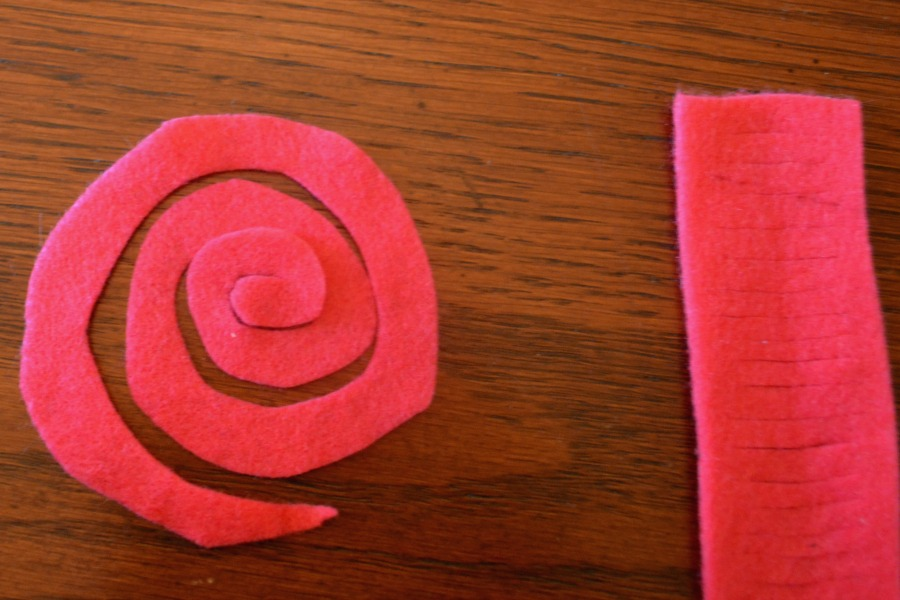 Cut outs from felt waiting to be rolled into flowers