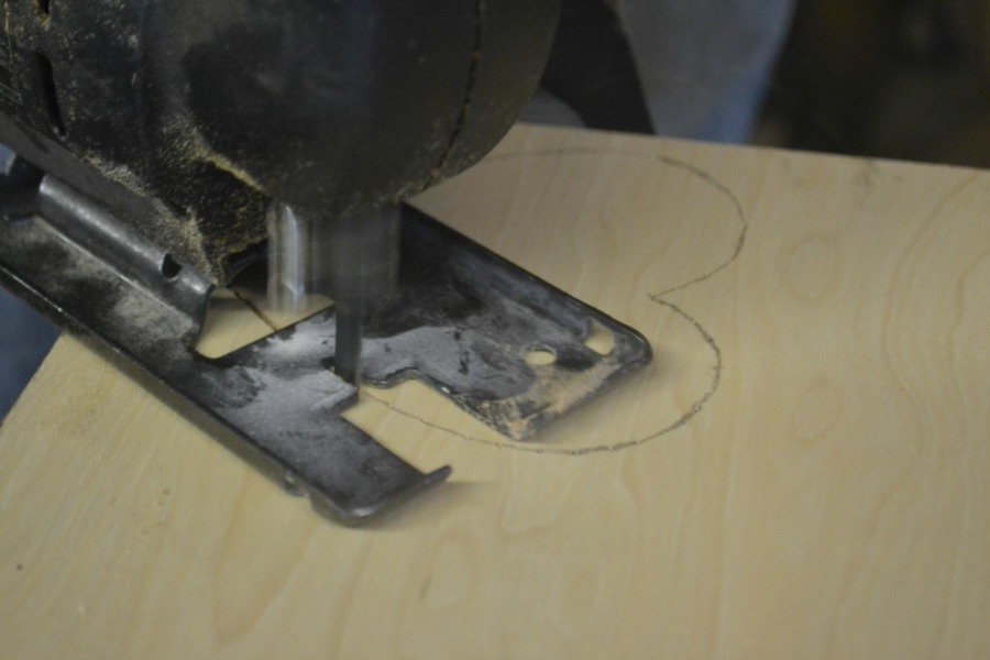Cutting a heart coaster with a jigsaw