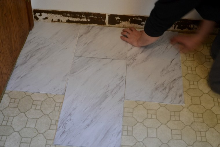 Installation of vinyl peel and stick tile is a slow steady process