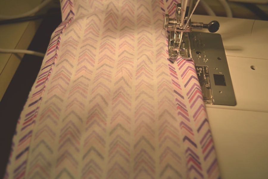 A close up of a seam being sewed on a sewing machine