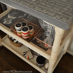 An above side view of a finished three tiered craft cart with French script on top and craft supplies on the shelves