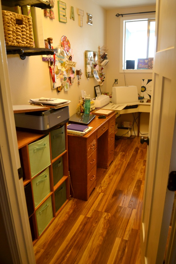 A view from the door into a long and narrow craft room