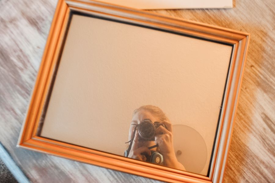 A closeup with the photographer's reflection in the mirror from above