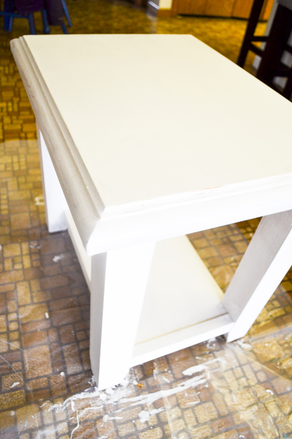 An above view of an end table that has been painted white