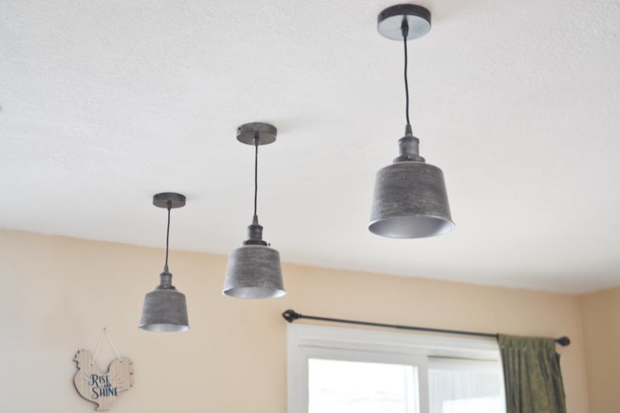 A close up of three pendant lights