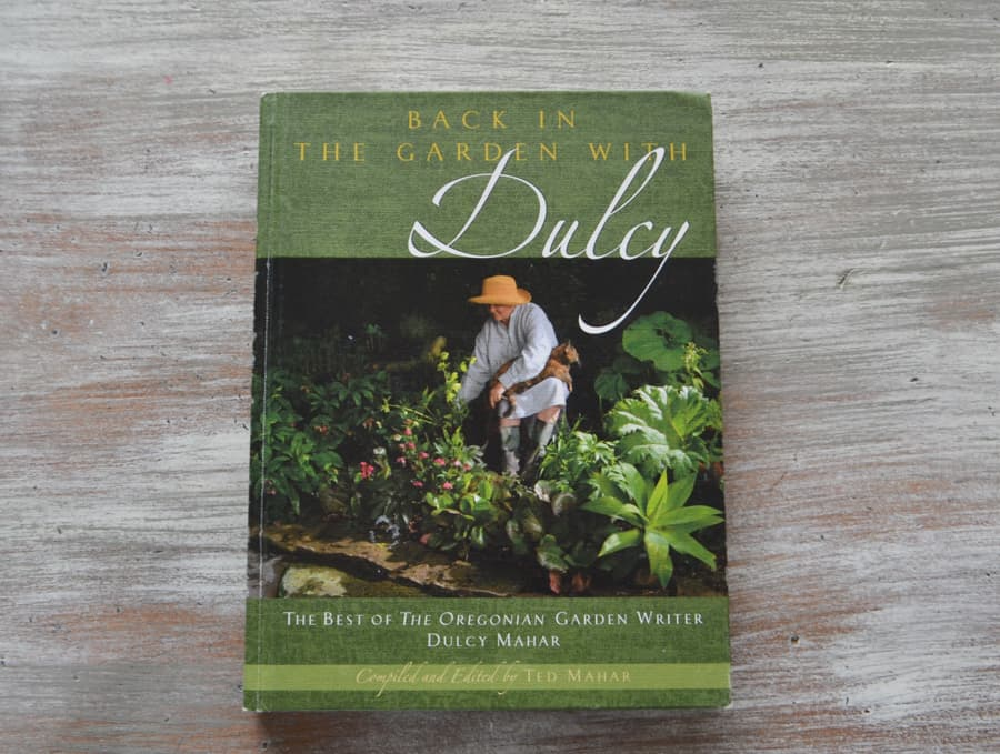 "An above view of the green book ""Back in the Garden with Darcy"""