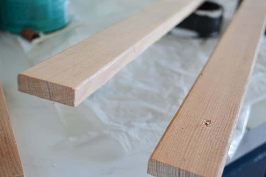 """A close up of small trim pieces used to create the """"frame"""" for the sign"""