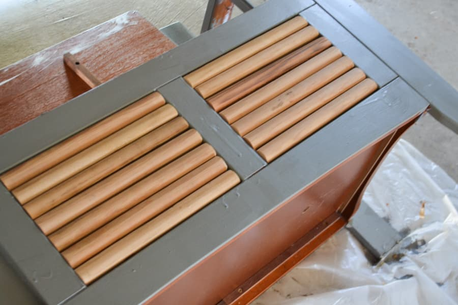 A close up of light wood colored rounded trim installed on a bench indentation