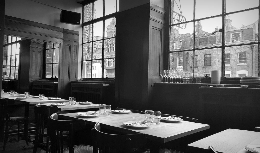 Review of Brat restaurant London, where large windows look out onto Shoreditch