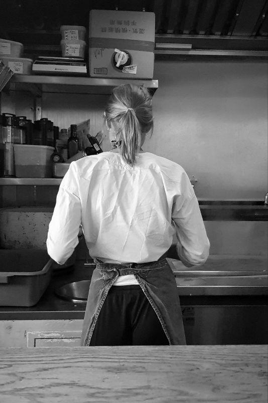 Chef at work making Japanese noodles behind the kitchen counter