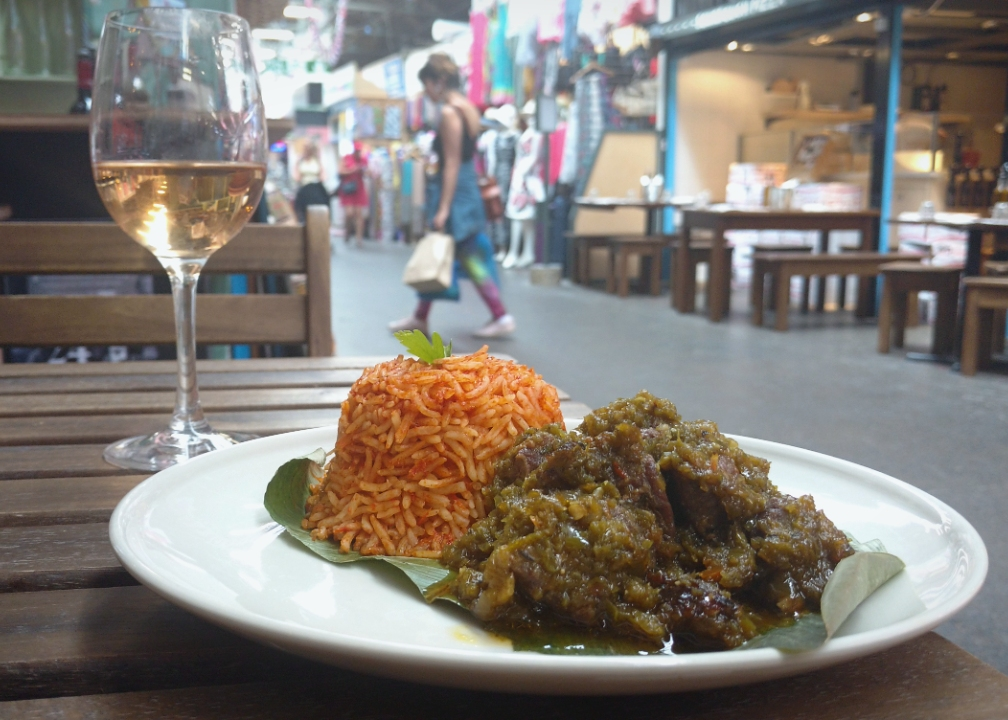 Nigerian ayamase beef stew and a glass of wine in Tooting Market