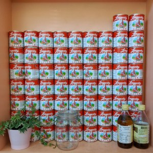Stack of tin cans decorating the walls of Mei Mei in Borough Market London