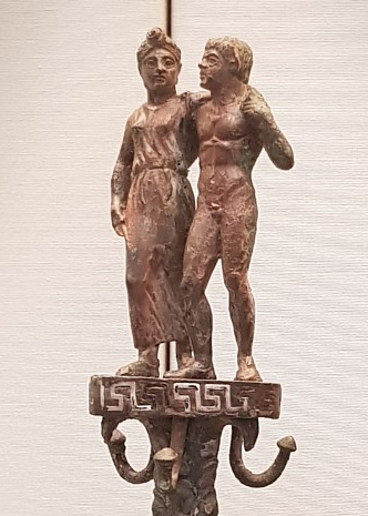 Etruscan utensil holder showing a satyr and maenad