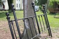 Repurpose an Old Headboard Into a Garden Fence