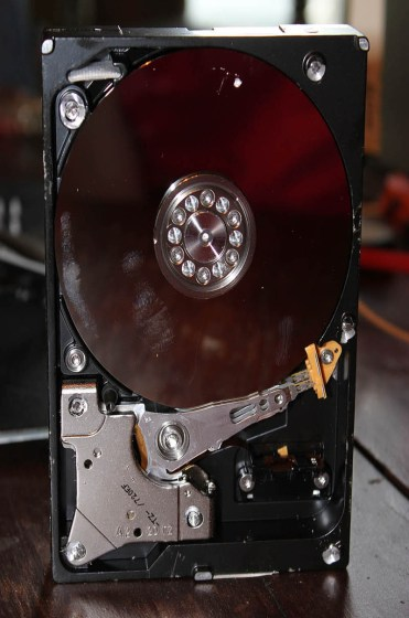 What should I do with an old computer? Repurpose your old computer into a hard drive clock, pencil holder, or art!