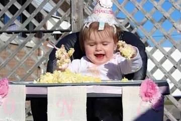 1st birthday girl in high chair