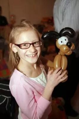 Little girl with balloon animal