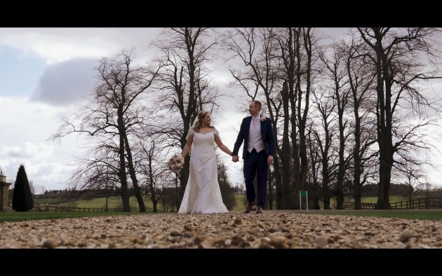 Wedding video filmed at Chicheley Hall with bride and groom walking