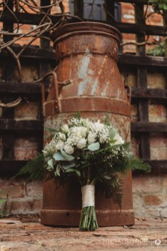 brides bouquets in front of milk churm