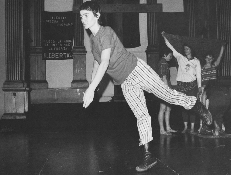 Carmen Beuchat of The Natural History of the American Dancer, 1974. The wooden cross at the Sanctuary's north end was made out of beams from nearby burned-out tenements—a replacement for the church's silver cross, which had been stolen (the wooden cross, along with the remaining pews, would be removed in the 1976 upgrade/renovation). Courtesy Danspace Project