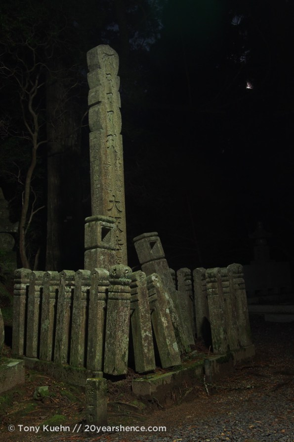 A grave marker by moonlight