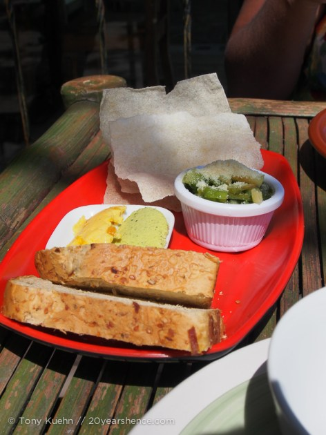 freshly baked bread accompanied with a sweet mango butter and zesty pesto spread