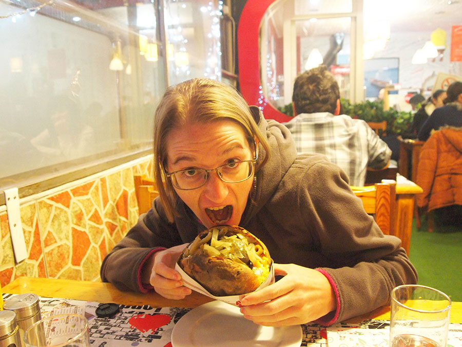 Rachel eating a kumpir (loaded baked potato) in Ankara.