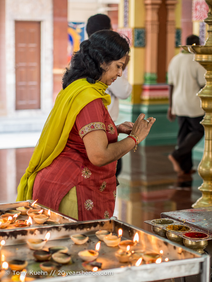 Lady making offering at Sri Mahamariamman