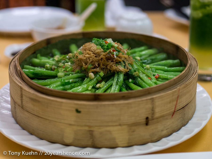 Steamed green beans topped with shredded fermented veggies