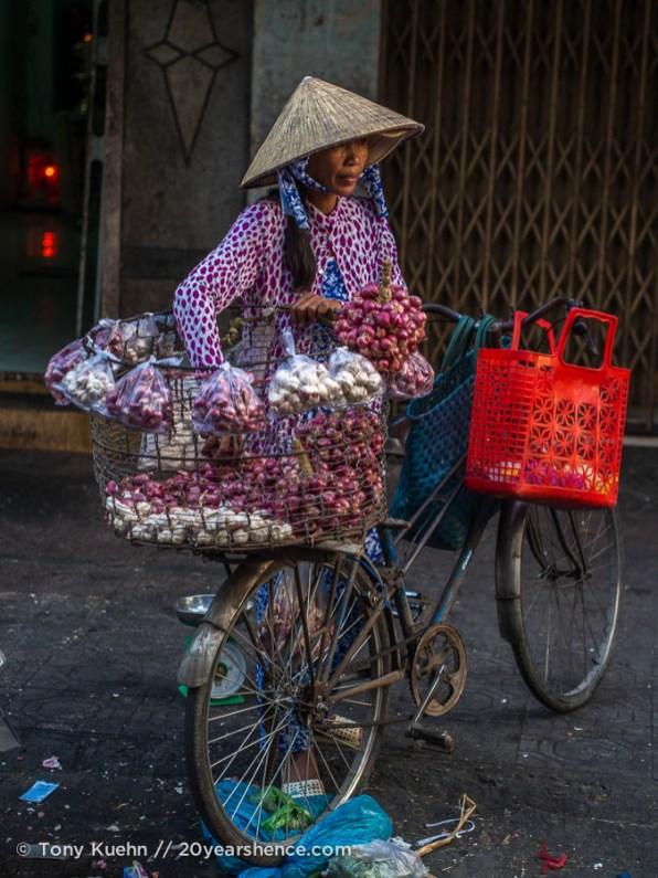 Shallot vendor. Ho Chi Minh City, Vietnam